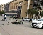 惠州一小车与摩托相撞,小车车头变形,女子倒地不起